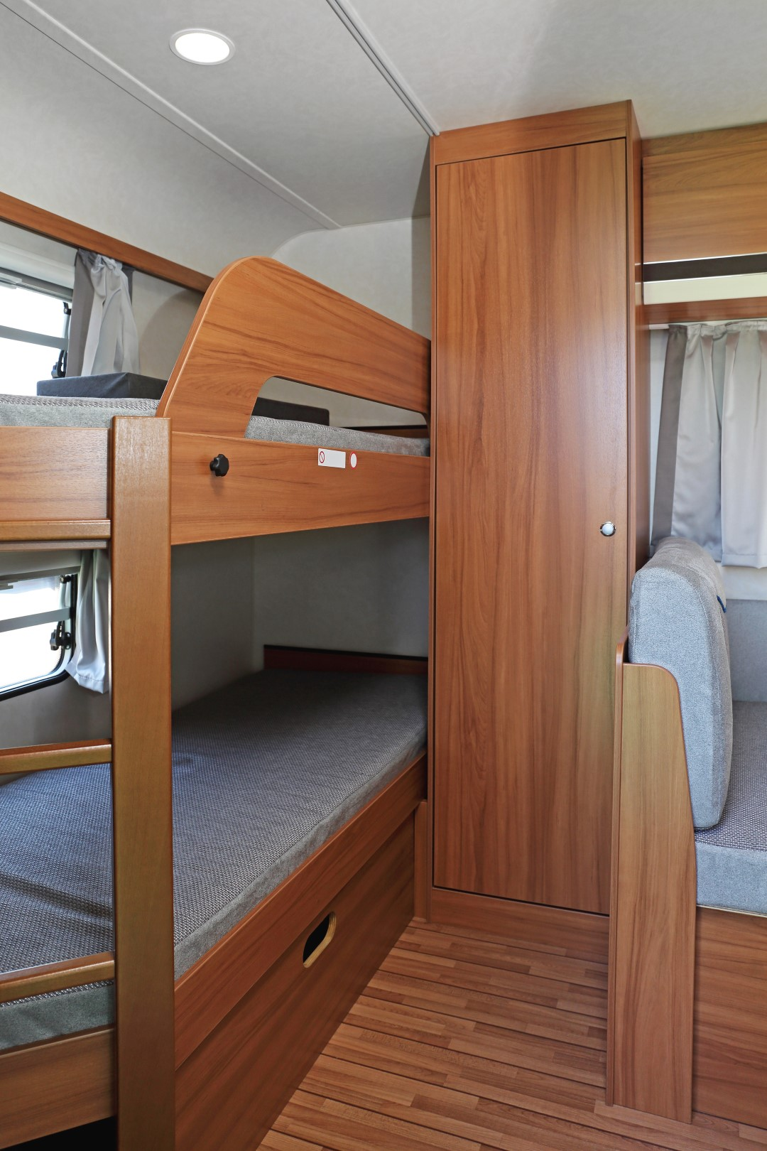 View of bunkbeds inside a bunkhouse-style RV