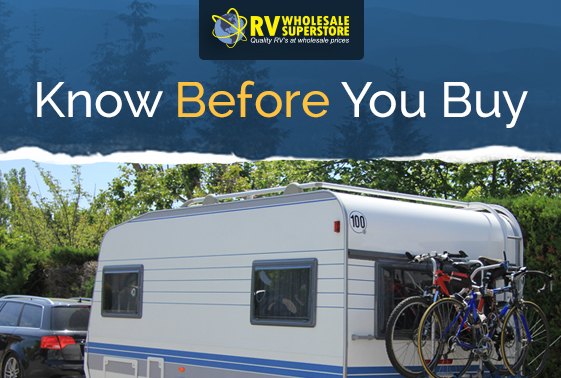 Small RV travel trailer with bicycle on rack