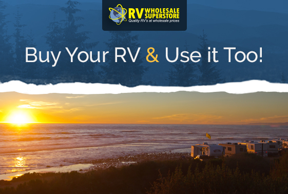 RVs parked on a beach at sunset