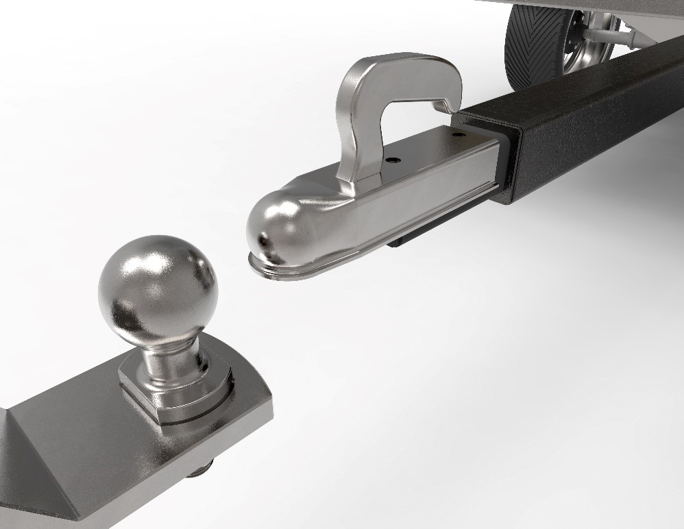 silver ball mount hitch is positioned in front of a trailer coupler