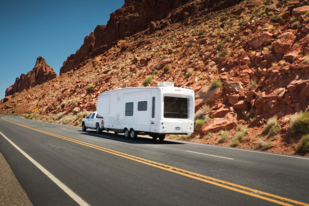 Truck pulling 5th Wheel RV in Western US