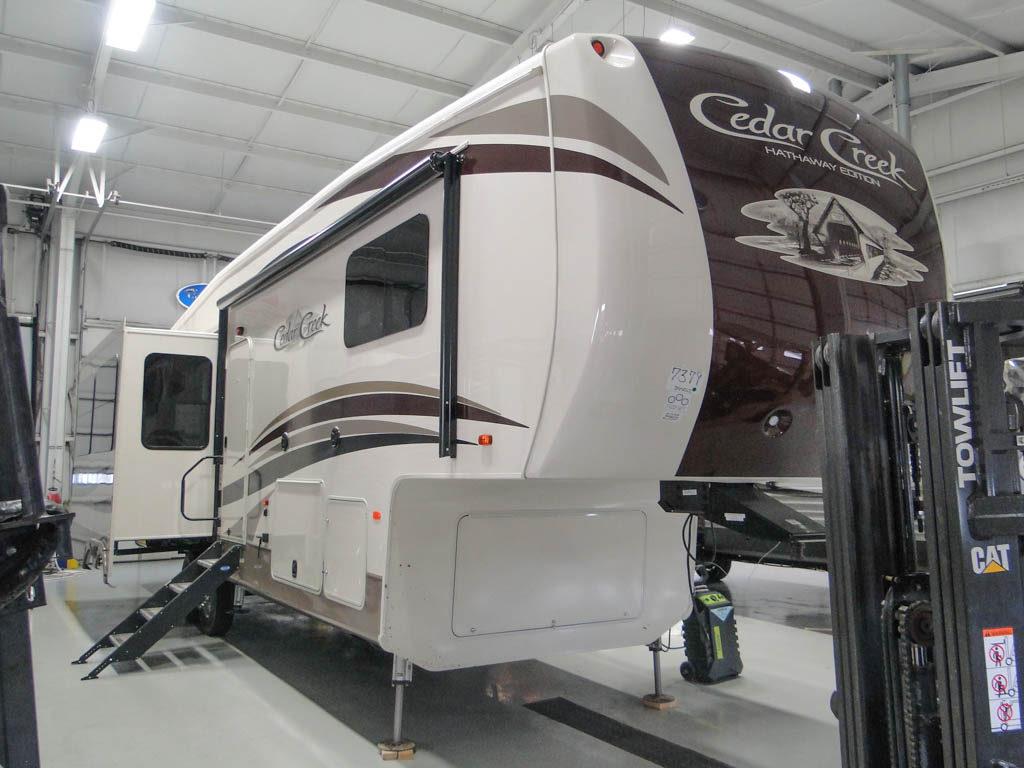 2017 Cedar Creek 34RL2 RV in a garage.
