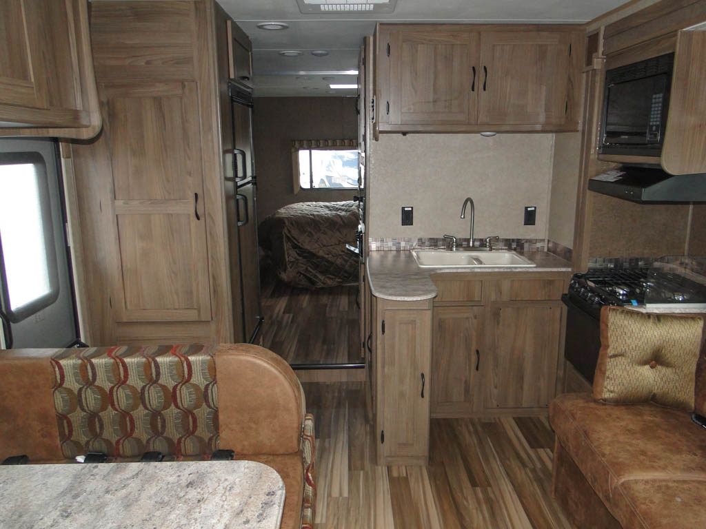 Interior of the 2017 Freelander 31BH showing the kitchen and dinette.
