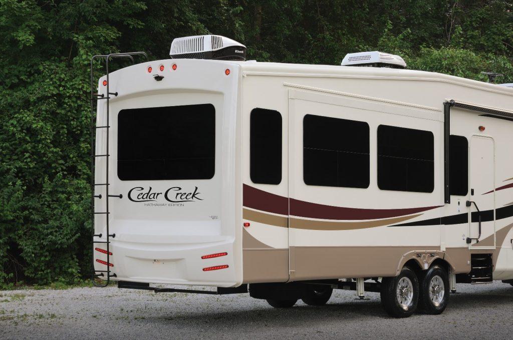 Rear angle of a Forest River Cedar Creek fifth wheel trailer.