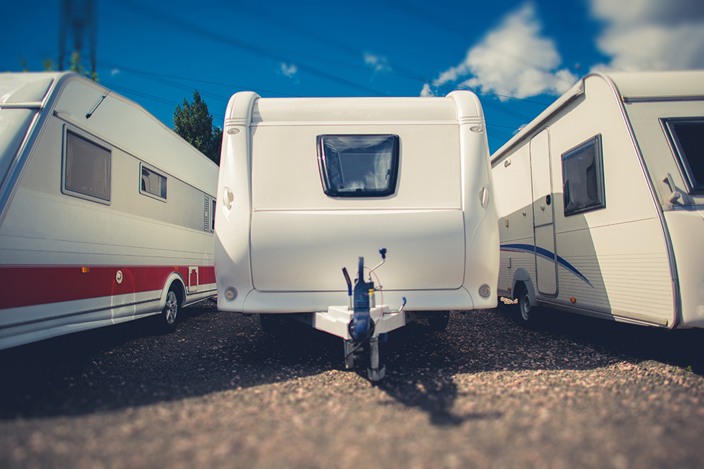 An RV dealer lot with different types of RVs.