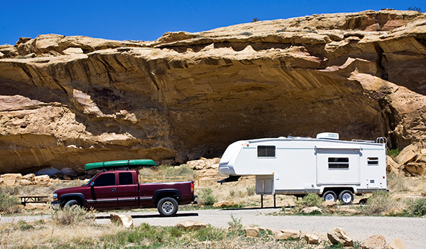 A fifth-wheel RV parked at a national park in New Mexico.