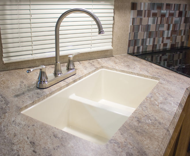Clean sink surrounded by countertop.