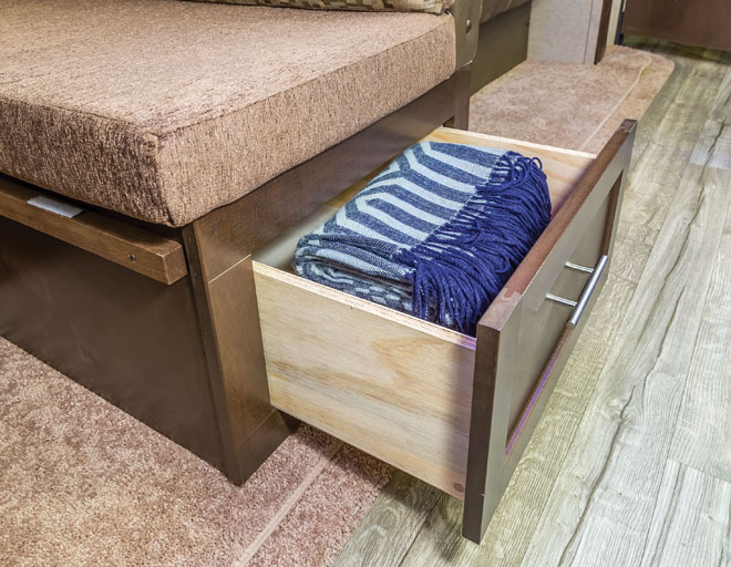 RV bedroom shows a drawer beneath the bed.
