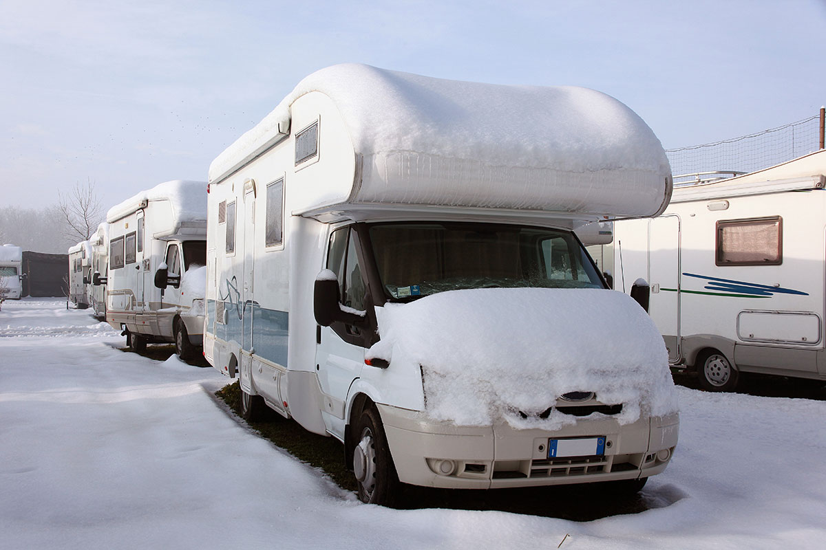 Motorhomes ready for RVing in winter in a lot.