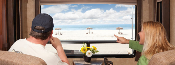 Couple enjoying the beach view during a snowbird RV trip