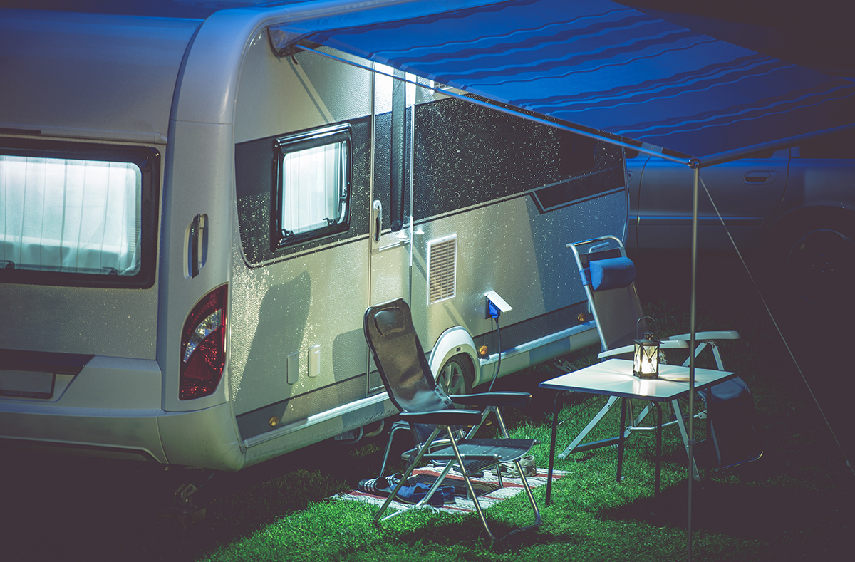A family practicing RV security by keeping the outside of their RV well-lit.