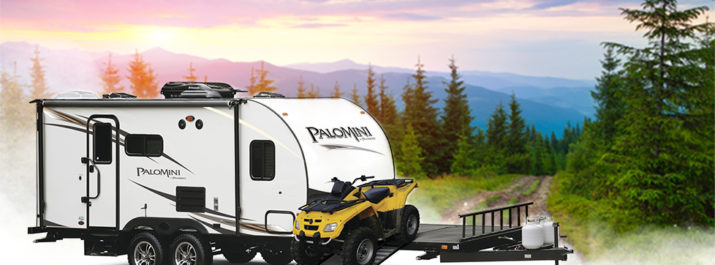 An ATV rolls down the ramp of a PaloMini RV ready to explore the surrounding trails