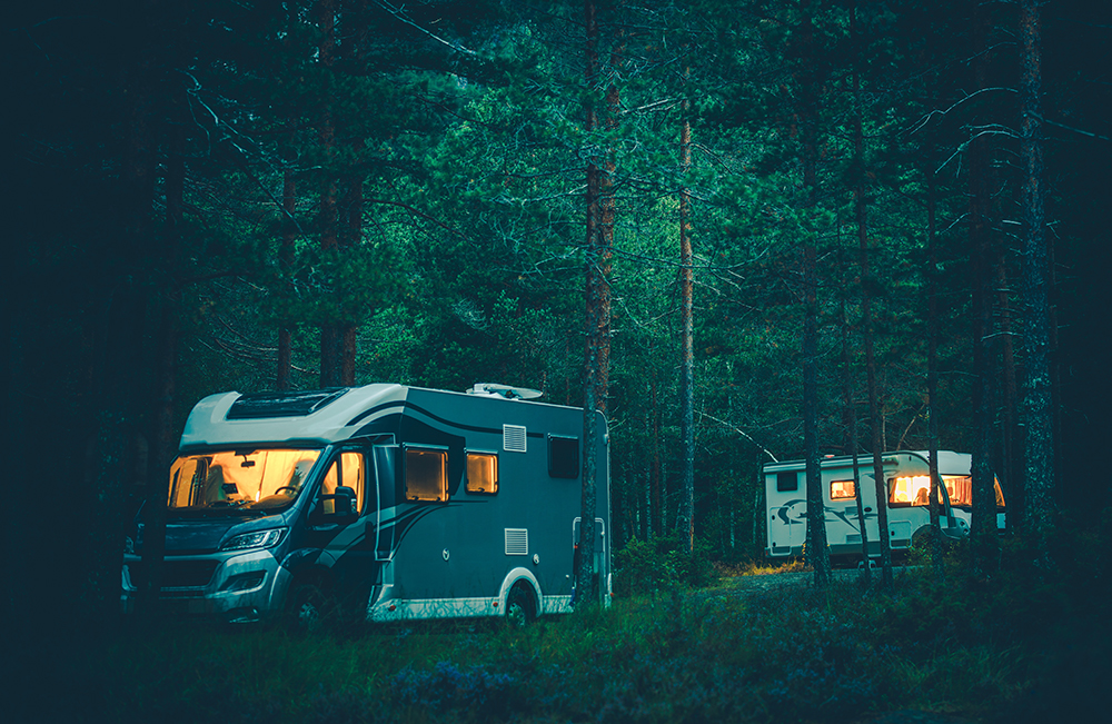 Two RVs boondocking deep woods