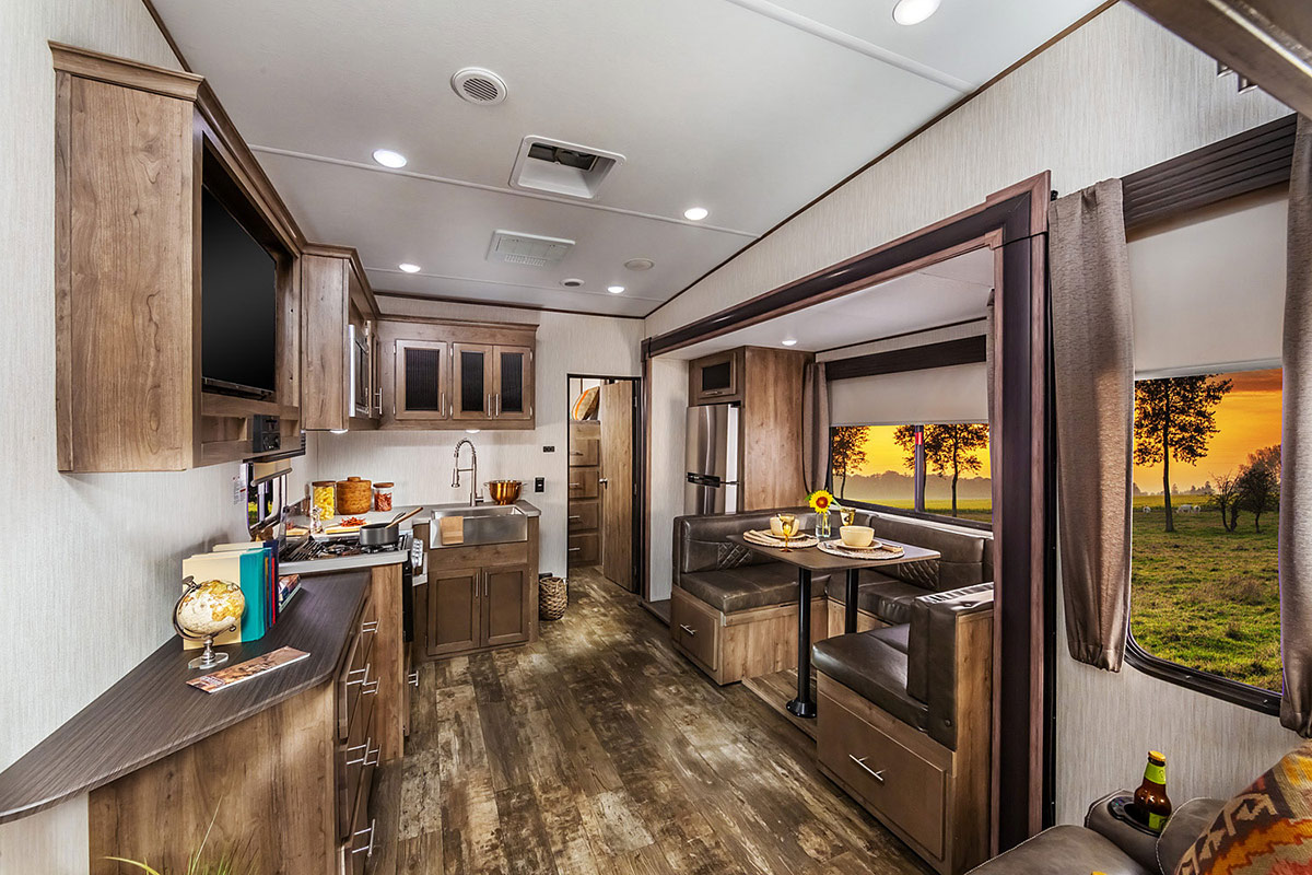 The kitchen and dining area of the 2019 Sabre SS150 bunkhouse model 301BH